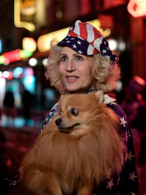 A woman, dressed in colours of the US national flag, is pictured outside the Harry's New York Bar in Paris on November 8. AFP/Getty Images