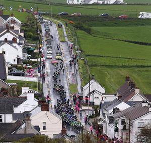 10th May 2014  Photo by William Cherry/Presseye  The peloton to goes through Ballintoy during Stage 2 of the 97th Giro dÄôItalia. The 219km stage started in Belfast and travelled out the North Coast before finishing at the City Hall, Belfast.