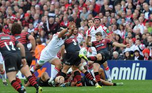 John Afoa charges down Owen Farrell during theHeineken Cup quarter final game between Ulster and Saracens at Ravenhill, Belfast. Photo: Pacemaker