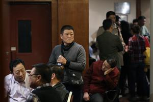 BEIJING, CHINA - MARCH 12:  Chinese relatives of the passengers onboard Malaysia Airlines flight MH370 gather inside the relative area at Lido Hotel on March 12, 2014 in Beijing, China. Officials have expanded the searh area for missing Malaysia Airlines flight MG370 to include more of the Gulf of Thailand between Malayisa and Vietnam and land along the Malay Pensinusula. (Photo by Lintao Zhang/Getty Images)