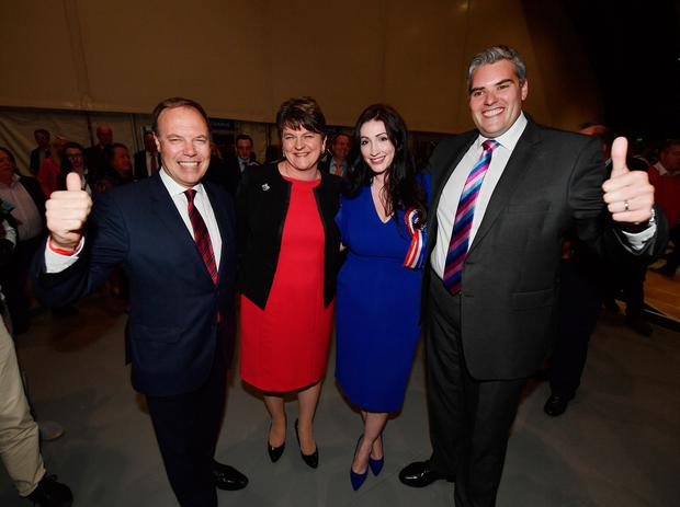 DUP leader Arlene Foster (2nd L), DUP deputy leader and north Belfast candidate Nigel Dodds (L), Emma Little Pengelly (2nd R) DUP south Belfast candidate and Gavin Robinson (R) DUP east Belfast candidate celebrate at the Belfast count centre on June 9, 2017 in Belfast, Northern Ireland. After a snap election was called the United Kingdom went to the polls yesterday, after a closely fought election the results from across the country are being counted and an overall result is expected in the early hours. (Photo by Charles McQuillan/Getty Images)