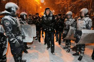 Ukrainian lawmaker and chairman of the opposition party Udar (Punch), WBC heavyweight boxing champion Vitali Klitschko surrounded by police trying to stop possible clashes between police and Pro-European Union activists in Kiev, Ukraine, Monday, Dec. 9, 2013.