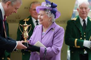 ASCOT, ENGLAND - JUNE 20:  Queen Elizabeth II holds the Gold Cup and Prince Andrew, Duke of York after Ryan Moore riding Estimate won The Gold Cup during Ladies' Day on day three of Royal Ascot at Ascot Racecourse on June 20, 2013 in Ascot, England.  (Photo by Chris Jackson/Getty Images for Ascot Racecourse)