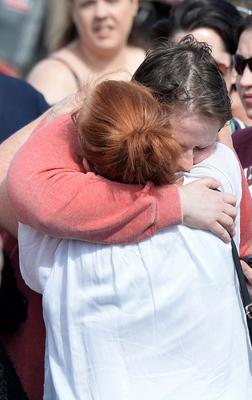"""PACEMAKER BELFAST  18/4/2019 Sarah Canning Partner of Lyra McKee during a vigil  at the scene after 29-year-old Lyra McKee who was shot dead  during rioting after police searches in Derry's Creggan area on Thursday night. Assistant Chief Constable Mark Hamilton said the New IRA """"are likely to be the ones behind this"""" and detectives have started a murder inquiry. Photo Colm Lenaghan/ Pacemaker Press"""