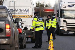Garda stop vehicles at a checkpoint on the Irish border between Emyvale and Aughnacloy (Liam McBurney/PA)