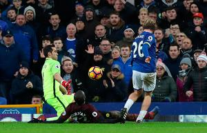 "Everton's Tom Davies scores his side's third goal during the Premier League match at Goodison Park, Liverpool. PRESS ASSOCIATION Photo. Picture date: Sunday January 15, 2017. See PA story SOCCER Everton. Photo credit should read: Peter Byrne/PA Wire. RESTRICTIONS: EDITORIAL USE ONLY No use with unauthorised audio, video, data, fixture lists, club/league logos or ""live"" services. Online in-match use limited to 75 images, no video emulation. No use in betting, games or single club/league/player publications."