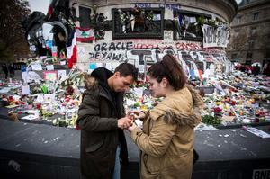 People light candles amongst tributes laid to victims of the Paris attacks at the foot of the Monument a La Republique in Paris on November 16, 2015.    Islamic State jihadists claimed a series of coordinated attacks by gunmen and suicide bombers in Paris on November 13 that killed at least 129 people in scenes of carnage at a concert hall, restaurants and the national stadium. AFP PHOTO /  LIONEL BONAVENTURELIONEL BONAVENTURE/AFP/Getty Images