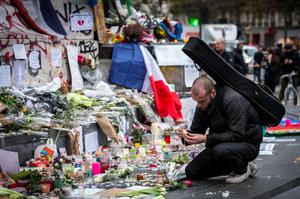 A man lights a candle amongst tributes laid to victims of the Paris attacks at the foot of the Monument a La Republique in Paris on November 16, 2015.    Islamic State jihadists claimed a series of coordinated attacks by gunmen and suicide bombers in Paris on November 13 that killed at least 129 people in scenes of carnage at a concert hall, restaurants and the national stadium. AFP PHOTO /  LIONEL BONAVENTURELIONEL BONAVENTURE/AFP/Getty Images