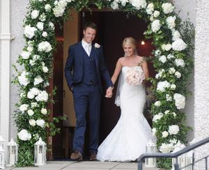 1/6/2013. Helen McConnell now Evans and her new husband Jonny Evans, Manchester United and Northern Ireland football star, after their wedding at Clough Presbyterian Church in County Antrim this afternoon. Picture Charles McQuillan/Pacemaker.
