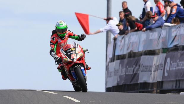 Glenn Irwin (Bewiser Ducati) acknowledges the red flag at Black Hill during today's feature superbike race.  Photo by David Maginnis/Pacemaker Press