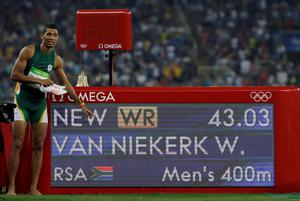 South Africa's Wayde Van Niekerk celebrates his new world record in the men's 400-meter final during the athletics competitions of the 2016 Summer Olympics at the Olympic stadium in Rio de Janeiro, Brazil, Sunday, Aug. 14, 2016. (AP Photo/David J. Phillip)