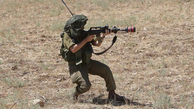 An Israeli soldier shoots tear gas towards Palestinian protesters against the Israeli military action in Gaza, during a demonstration at Hawara checkpoint near the West Bank city of Nablus on Thursday, July 24, 2014. (AP Photo/Nasser Ishtayeh)