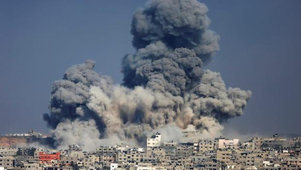 Smoke from the explosion of an Israeli strike rise over Gaza City, Tuesday, July 29, 2014. (AP Photo/Hatem Moussa)