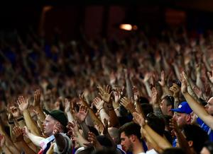 Iceland fans cheer during Euro 2016 round of 16 football match between England and Iceland at the Allianz Riviera stadium in Nice on June 27, 2016.   / AFP PHOTO / TOBIAS SCHWARZTOBIAS SCHWARZ/AFP/Getty Images