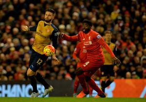 Arsenal's French striker Olivier Giroud (L) vies with Liverpool's Ivorian defender Kolo Toure during the English Premier League football match between Liverpool and Arsenal at Anfield stadium in Liverpool, north-west England on January 13, 2016. AFP PHOTO / PAUL ELLIS RESTRICTED TO EDITORIAL USE. NO USE WITH UNAUTHORIZED AUDIO, VIDEO, DATA, FIXTURE LISTS, CLUB/LEAGUE LOGOS OR 'LIVE' SERVICES. ONLINE IN-MATCH USE LIMITED TO 75 IMAGES, NO VIDEO EMULATION. NO USE IN BETTING, GAMES OR SINGLE CLUB/LEAGUE/PLAYER PUBLICATIONS.PAUL ELLIS/AFP/Getty Images