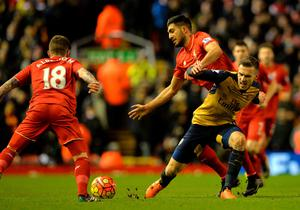 Arsenal's Welsh midfielder Aaron Ramsey (R) vies with Liverpool's German midfielder Emre Can during the English Premier League football match between Liverpool and Arsenal at Anfield stadium in Liverpool, north-west England on January 13, 2016. AFP PHOTO / PAUL ELLIS RESTRICTED TO EDITORIAL USE. NO USE WITH UNAUTHORIZED AUDIO, VIDEO, DATA, FIXTURE LISTS, CLUB/LEAGUE LOGOS OR 'LIVE' SERVICES. ONLINE IN-MATCH USE LIMITED TO 75 IMAGES, NO VIDEO EMULATION. NO USE IN BETTING, GAMES OR SINGLE CLUB/LEAGUE/PLAYER PUBLICATIONS.PAUL ELLIS/AFP/Getty Images