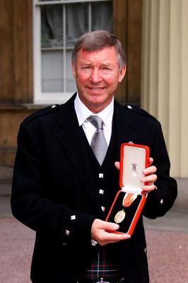 File photo dated 20/07/1999 of Manchester United manager Alex Ferguson, who received a knighthood from the Queen, during an Investiture ceremony at Buckingham Palace. PRESS ASSOCITAION Photo. Issue date: Wednesday May 8, 2013. Sir Alex Ferguson will retire at the end of this season, Manchester United have announced. See PA Story SOCCER Man Utd. Photo credit should read: PA Wire.