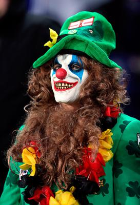 A Northern Ireland fan in the stands in a scary clown fancy dress during the 2018 FIFA World Cup Qualifying match at the HDI Arena, Hannover. PA