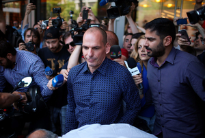 Former Greek finance minister Yanis Varoufakis faces a barage of media questions as he leaves the finance ministry after resigning this morning on July 6, 2015 in Athens, Greece. Politicians in Europe and Greece are planning emergency talks after Greek voters rejected EU proposals to pay back it's creditors creating an uncertain future for Greece.  (Photo by Christopher Furlong/Getty Images)