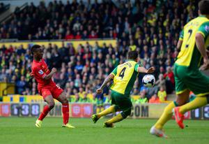 NORWICH, ENGLAND - APRIL 20:  Raheem Sterling of Liverpool scores their third goal during the Barclays Premier League match between Norwich City and Liverpool at Carrow Road on April 20, 2014 in Norwich, England.  (Photo by Jamie McDonald/Getty Images)