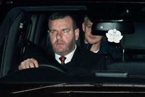 Manchester United's  Norwegian caretaker manager Ole Gunnar Solskjaer is driven in to the club's Carrington training complex.