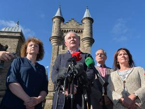 Deputy First Minister Martin McGuinness with party colleagues speaks to the media at Storming Castle. Pic Colm Lenaghan/Pacemaker