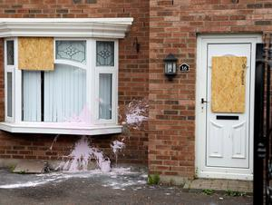 Officers attended to find a bullet hole in the front window of the house, and a bullet located within an interior wall.