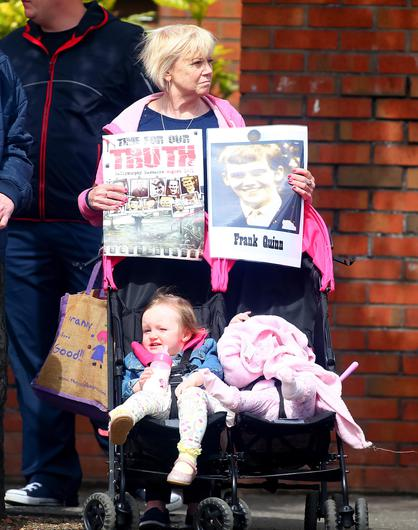 Protestors await the arrival of Prince Charles and Camilla at St Patrick's Church, Donegall Street, Belfast.