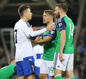 Pacemaker Belfast 8-10-16 Northern Ireland v San Marino - World Cup Qualifier Northern Ireland's Jamie Ward and San Marinos Matteo Vitaioli during this evenings game at the National Stadium, Belfast.  Photo by David Maginnis/Pacemaker Press