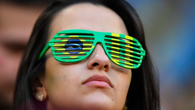 A Brazil's fan watch the Russia 2018 World Cup round of 16 football match between Brazil and Mexico at the Samara Arena in Samara on July 2, 2018.