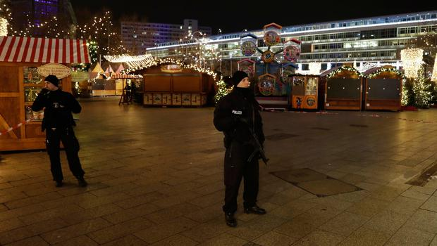 Police guard a Christmas market after a truck ran into the crowded Christmas market in Berliin Berlin, Germany, Monday, Dec. 19, 2016. (AP Photo/Michael Sohn)