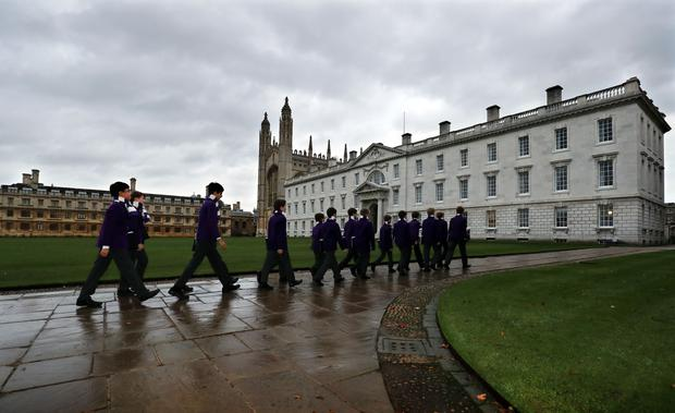 King's College choristers make they way to the chapel for rehearsals in previous years (Chris Radburn/PA)