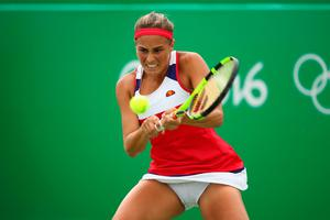 RIO DE JANEIRO, BRAZIL - AUGUST 11:  Monica Puig of Puerto Rico plays a backhand during the women's singles quarterfinal match against Laura Siegemund of Germany on Day 6 of the 2016 Rio Olympics at the Olympic Tennis Centre on August 11, 2016 in Rio de Janeiro, Brazil.  (Photo by Clive Brunskill/Getty Images)