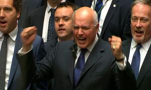 Works and Pensions Secretary Iain Duncan Smith punches the air as he listens to Chancellor of the Exchequer reveal details of the 2015 Budget