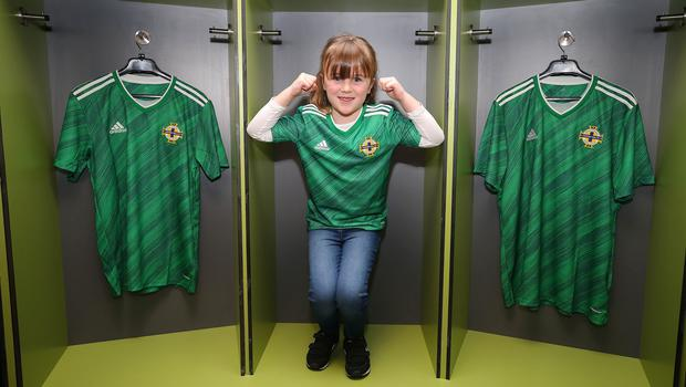 Six-year-old Megan Lewis pictured with the new Northern Ireland kit at Tuesday's launch at Windsor Park (Jonathan Porter/PressEye)