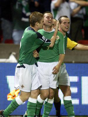 David Healy celebrates after scoring against England