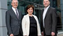 Kevin Holland of Invest NI with Economy Minister Diane Dodds and Darren Dillon of Microsoft