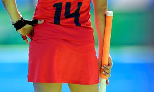 The USA's Katie Reinprecht waits for playing on the sidelines during the women's quarterfinal field hockey USA vs Germany match of the Rio 2016 Olympics Games at the Olympic Hockey Centre in Rio de Janeiro on August 15, 2016. / AFP PHOTO / MANAN VATSYAYANAMANAN VATSYAYANA/AFP/Getty Images