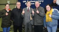 Sinn Fein's Mickey Brady(centre) is returned as MP for Newry and Armagh. Photo by Jonathan Porter / Press Eye.