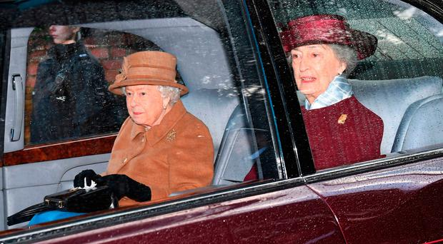 The Queen leaves church yesterday after attending a morning service at St Mary Magdalene Church in Sandringham