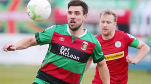 Glentoran's Gavin Peers with Cliftonville's Liam Bagnall. Credit: INPHO/Jonathan Porter