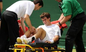 Argentina's Guido Pella is stretchered off in his match against Canada's Jesse Levine during day Two of the Wimbledon Championships at The All England Lawn Tennis and Croquet Club, Wimbledon. PRESS ASSOCIATION Photo. Picture date: Tuesday June 25, 2013. See PA story TENNIS Wimbledon. Photo credit should read: Andrew Matthews/PA Wire. RESTRICTIONS: Editorial use only. No commercial use. No video emulation. No use with any unofficial third party logos.