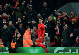 Liverpool's Welsh striker Ben Woodburn (L) celebrates scoring his team's second goal during the English League Cup quarter-final football match between Liverpool and Leeds United at Anfield in Liverpool, north west England on November 29, 2016. AFP/Getty Images