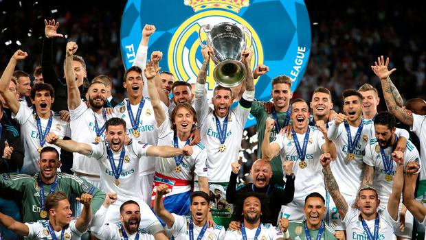 Real Madrid celebrate with the trophy after winning the UEFA Champions League Final at the NSK Olimpiyskiy Stadium, Kiev. Nick Potts/PA Wire
