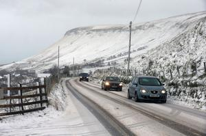 Snow in the Glens of Antrim, as an orange weather alert is announced in Northern Ireland. PRESS ASSOCIATION Photo. Picture date: Wednesday January 28, 2015. A cold weather front is to sweep in with temperatures expected to drop as much as 10C to below zero overnight into Thursday. See PA story WEATHER Cold. Photo credit should read: Niall Carson/PA Wire