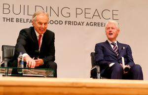 "Former British Prime Minister Tony Blair (L) and former US president Bill Clinton attend a special event to mark the twentieth anniversary of the Good Friday Agreement, at Queen's University in Belfast on April 10, 2018. Twenty years after Northern Ireland's landmark peace agreement, former British premier Tony Blair has recalled how close talks came to collapse -- and warned it risks being undermined by Brexit. ""I did not know if we were going to get an agreement until literally minutes before it happened,"" Blair said, ahead of a visit to Belfast to mark Tuesday's anniversary of the 1998 Good Friday accords. / AFP PHOTO / Paul FAITHPAUL FAITH/AFP/Getty Images"