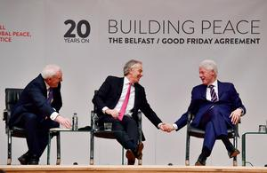 BELFAST, NORTHERN IRELAND - APRIL 10: Former US President Bill Clinton holds (R) hands with former British Prime Minister Tony Blair as they attend an event to mark the 20th anniversary of the Good Friday Agreement at Queens university on April 10, 2018 in Belfast, Northern Ireland. Northern Ireland's present devolved system of government is based on this agreement and was a major part of the 1990's peace process.  (Photo by Charles McQuillan/Getty Images)