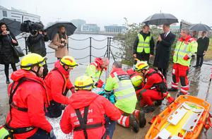 The Duke of Cambridge (4th right) sees the work of Lagan Search and Rescue, a rescue and lifeboat service that covers the Belfast Harbour Estate, River Lagan and the estuarial waters of Belfast Lough, in the Titanic Quarter, as part of his tour of Belfast. PRESS ASSOCIATION Photo. Picture date: Wednesday October 4, 2017. Brian Lawless/PA Wire