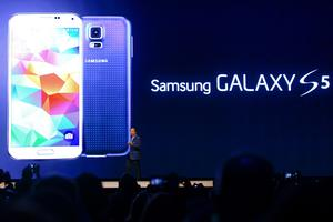 CEO and President of Samsung JK Shin presents the new Samsung Galaxy S5 during the first day of the Mobile World Congress 2013 at Forum Complex on February 24, 2014 in Barcelona, Spain.