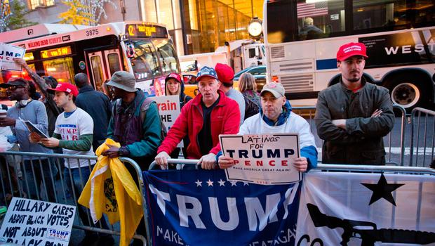 Supporters of Republican presidential nominee Donald Trump gather outside Trump Tower in New York City on election day November 8, 2016. / AFP PHOTO / DOMINICK REUTERDOMINICK REUTER/AFP/Getty Images